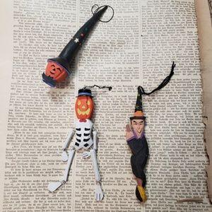 A witch, skeleton an pumpkin ornament.